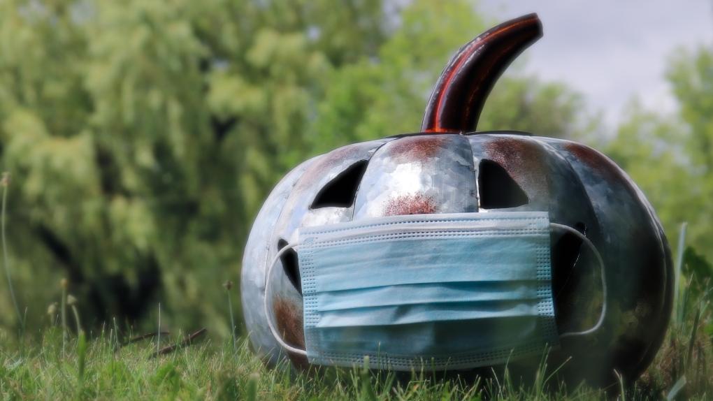 Jack-o-lantern wearing non-surgical blue mask