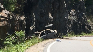A car collides with the rockface along White's Falls Road in Georgian Bay Township, Ont., on Fri., Aug. 14, 2020. (David Sullivan/CTV News)