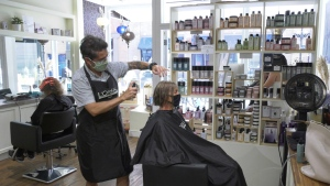 The Natural Hair Salon co-owner Phillip Ferreira puts the finishing touches on a clients hair. The Victoria business will be holding a fundraiser for Beirut on Saturday: (CTV News)
