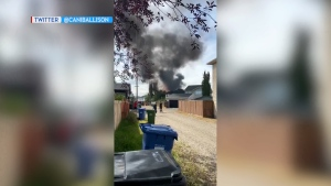 Smoke could be seen for quite a distance during a house fire Friday afternoon on Chaparral Terrace S.E. (Twitter/Caniballison)