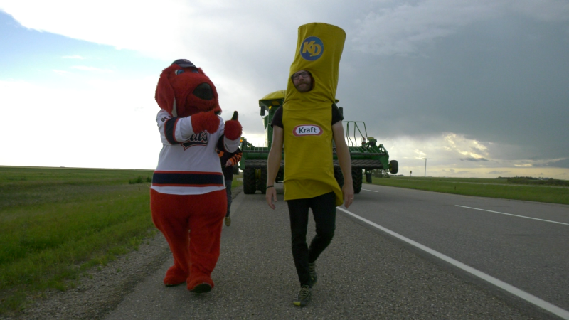 Bevan Harlton, also known as Noodle Boy, walks down the TransCanada Highway to rally support for Pense's Kraft Hockeyville campaign. (Claire Hanna/CTV News Regina)