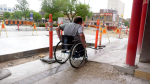 Allen Mankewich tries to maneuver his wheelchair through construction. (Source: Mike Arsenault/CTV News)