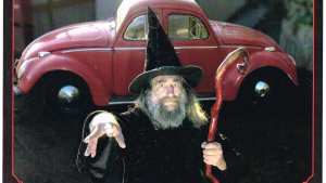 """Ian Brackenbury Channell, who now goes by Jack, is the Wizard of New Zealand. He was appointed to his position in 1990 by Prime Minister Mike Moore. The Wizard says he has a """"very unusual"""" car, which is a Volkswagon Beetle with two frontends and no backends. When he drives it, he says people don't know whether it's going forwards or backwards. He says it's not going which way that counts. It's having fun that counts, he says. Jack the Wizard is seen in this undated handout photo with his vehicle. (THE CANADIAN PRESS/HO)"""