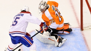 Montreal Canadiens centre Jesperi Kotkaniemi (15) shoots on Philadelphia Flyers goaltender Carter Hart (79) during first period of NHL Eastern Conference Stanley Cup first round playoff action in Toronto on Friday, August 14, 2020. THE CANADIAN PRESS/Frank Gunn