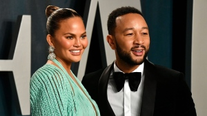 Chrissy Teigen, left, with her husband John Legend. (Frazer Harrison/Getty Images)