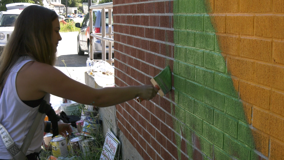 University of Waterloo Fine Arts student Ashley Guenette has been painting a mural along one of the sides of Minnow Lake Place as part of this year's UpHere Festival. Aug.15/20 (Ian Campbell/CTV News Northern Ontario)