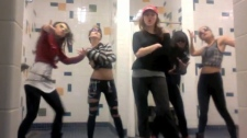 Miley Cyrus is joined by four friends, background, as she raps in a video posted on the website YouTube.