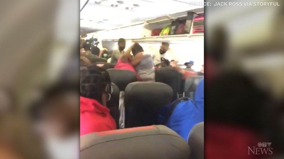 Caught on cam: A fight started before takeoff between two passengers on a North Carolina-bound plane.