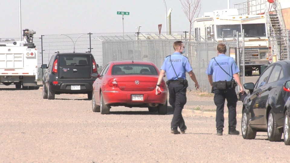 Security personnel posted near the mobile overdose prevention site in Lethbridge