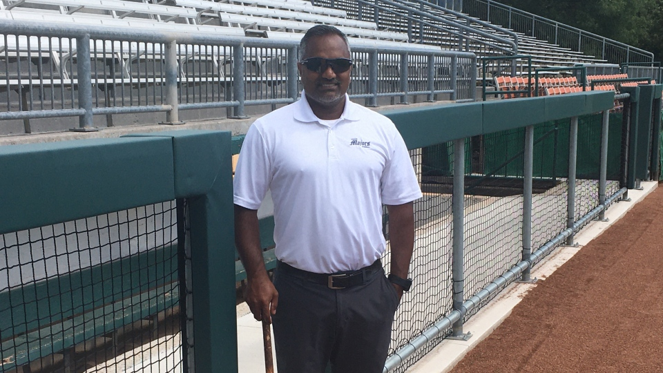 Roop Chanderdat, London Majors co-owner and manager, shows off the new railings in front of the dugouts at Labatt Park in London, Ont. on Tuesday, Aug. 18, 2020. (Brent Lale / CTV News)