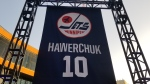 Dale Hawerchuk's banner is hanging in True North Square, where fans have gathered to pay tribute to the Winnipeg Jets legend. (CTV News Photo Daniel Timmerman)
