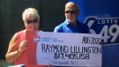 Gaye and Raymond Lillington collect a cheque worth $17.4 million in Halifax on Aug. 19, 2020, after winning a Lotto 6/49 prize. (Mike Lamb/CTV Atlantic)
