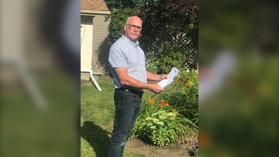 Ken Seville looking over the three photo radar tickets given to his relative in a 60-second span. Aug. 19, 2020. (CTV News Edmonton)