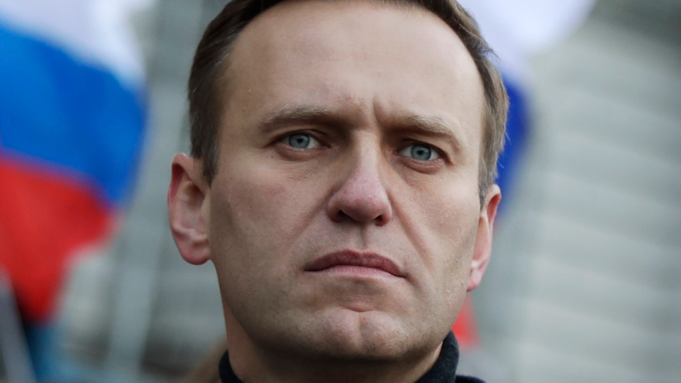 In this Feb. 29, 2020, file photo, Russian opposition activist Alexei Navalny takes part in a march in memory of opposition leader Boris Nemtsov in Moscow, Russia. (AP Photo/Pavel Golovkin, File)