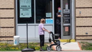 A woman attends a COVID testing centre at a Hospital in Ajax, Ont., on Tuesday July 28, 2020. (Chris Young/The Canadian Press)