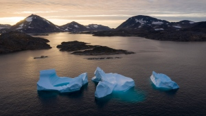 In this Aug. 16, 2019 file photo, icebergs float away as the sun rises near Kulusuk, Greenland. (AP Photo/Felipe Dana, File)