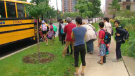 Students waiting to get on a school bus. (CTV News Toronto)
