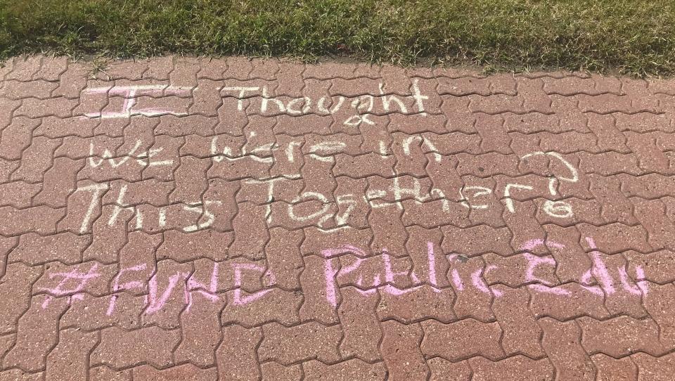 Safe September protest, chalk message