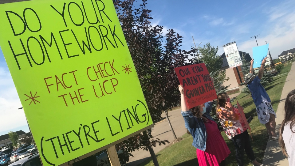 Beaumont protest, 'do your homework' sign
