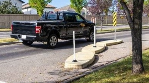 The city is installing these traffic calming curbs on Whelan Drive near MacNeil School. (Submitted/City of Regina)