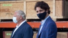Prime Minister Justin Trudeau stands with Ontario Premier Doug Ford during an announcement on N95 masks at a facility in Brockville, Ont., Friday, Aug. 21, 2020. THE CANADIAN PRESS/Adrian Wyld