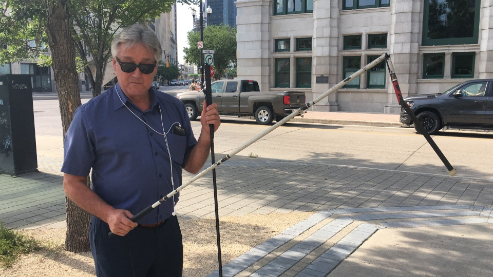 Coun. Ross Eadie's cane was snapped in two places after an accident with a cyclist on a sidewalk. (Source: Zachary Kitchen/ CTV News Winnipeg)