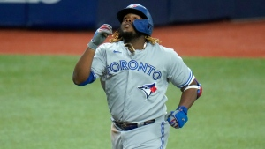 Toronto Blue Jays' Vladimir Guerrero Jr. (27) celebrates after hitting a solo home run off Tampa Bay Rays pitcher Ryan Yarbrough during the second inning of a baseball game Friday, Aug. 21, 2020, in St. Petersburg, Fla. (AP Photo/Chris O'Meara)