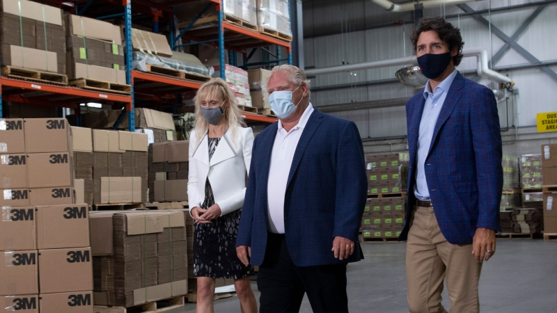 3M Canada President Penny Wise, Ontario Premier Doug Ford and Prime Minister Justin Trudeau make their way to an announcement at a facility in Brockville, Ont., Friday, Aug. 21, 2020. THE CANADIAN PRESS/Adrian Wyld