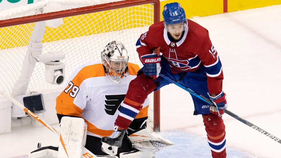 Montreal Canadiens centre Jesperi Kotkaniemi (15) leaps to try to deflect a shot in front of Philadelphia Flyers goaltender Carter Hart (79) during third period NHL Eastern Conference Stanley Cup first round playoff action in Toronto, Tuesday, Aug. 18, 2020. THE CANADIAN PRESS/Frank Gunn