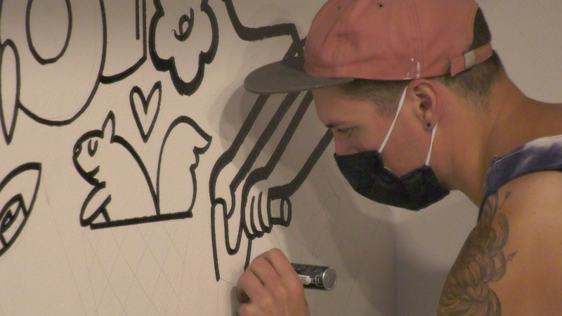 Ottawa's Robbie Lariviere is drawing the attention of visitors and residents with his unique style of murals. (Dave Charbonneau/CTV News Ottawa)