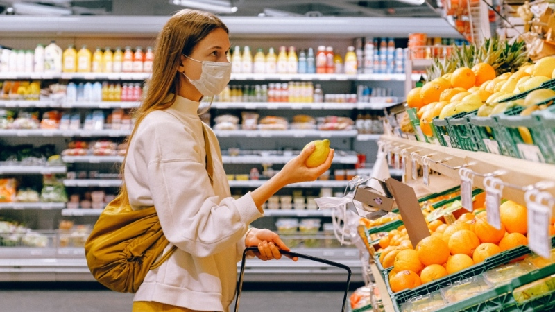 A woman wearing a mask is seen grocery shopping in this file photo. (Anna Shvets/Pexels)