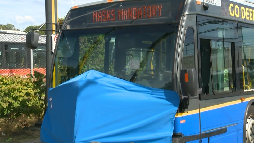 A TransLink bus is seen with a giant mask. As of Aug. 24, 2020, masks are now required on transit in Metro Vancouver.