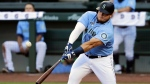 Seattle Mariners' Daniel Vogelbach connects for a double during an intrasquad baseball game Wednesday, July 22, 2020, in Seattle. THE CANADIAN PRESS/AP, Elaine Thompson