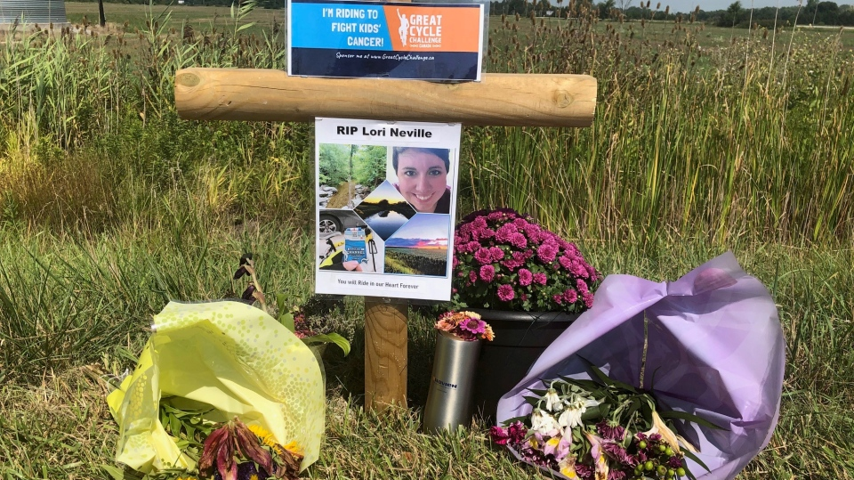 A roadside tribute to Lori Neville, who was struck and killed while cycling in a cancer fundraiser, is seen on Petrolia Line in St. Clair Township, Ont. on Monday, Aug. 24, 2020. (Jordyn Read / CTV News)