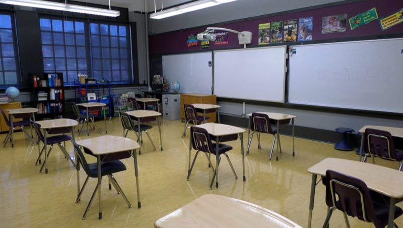An empty Calgary classroom with desks spaced apart ahead of the start of the fall semester