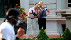 In this June 28, 2020 file photo, Mark and Patricia McCloskey emerged from their St. Louis mansion with guns after protesters walked onto their private street. (Laurie Skrivan/St. Louis Post-Dispatch via AP, File