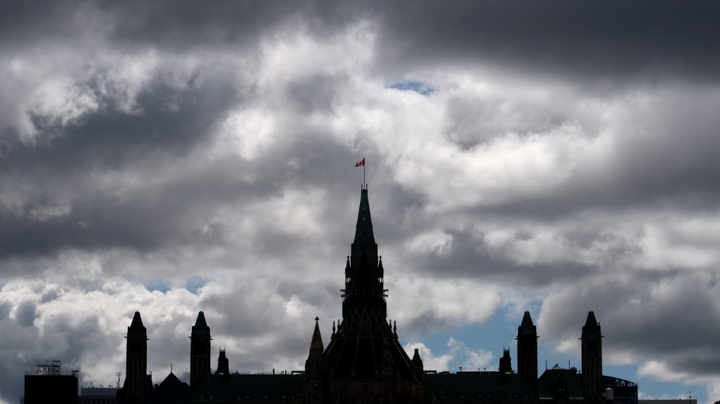 Clouds pass by the parliament buildings