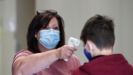 File photo of a child getting his temperature checked.