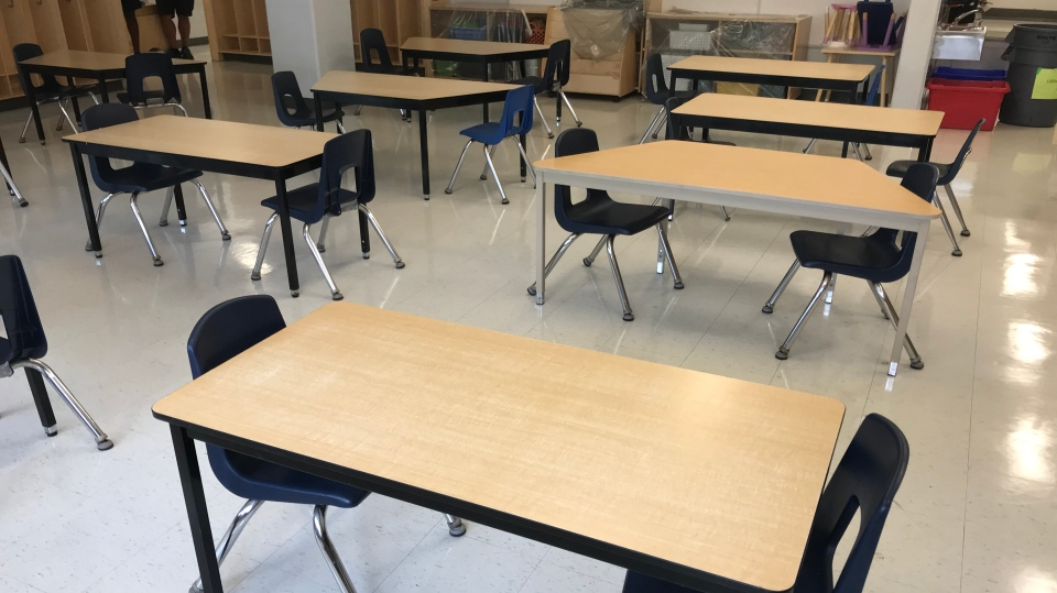 Staff prepares public school classrooms to welcome students in September with new COVID-19 measures in place in Windsor, Ont. On Tuesday, Aug. 25 2020. (Michelle Maluske/CTV Windsor)