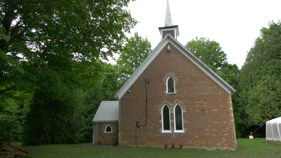 The 120-year-old church in Crystal Rock, Ont. looks okay from the outside, but inside the walls were thousands of bees. (Nate Vandermeer / CTV News Ottawa)