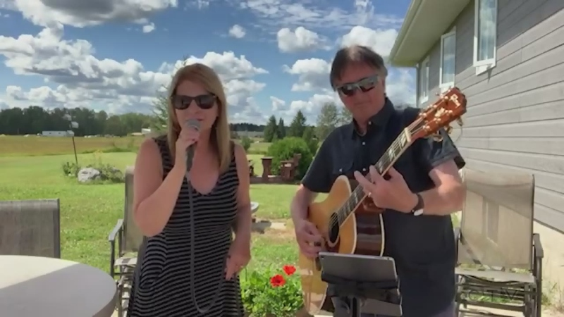 Estelle Deschamps and John Lemieux step outside in Cochrane to sing 'Baby You Decide.'