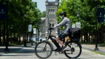 A person bicycles past the University of Toronto campus during the COVID-19 pandemic in Toronto on Wednesday, June 10, 2020. The Ontario government announces the framework for reopening of colleges and universities as early as of July. THE CANADIAN PRESS/Nathan Denette