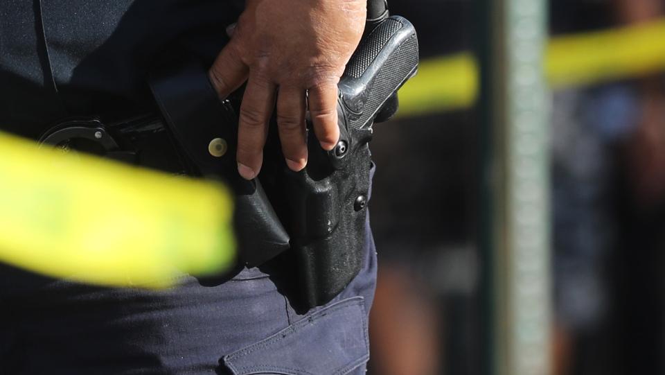 An NYPD officer's sidearm in a belt holster. (Spencer Platt/Getty Images/FILE/CNN)