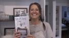 London Ont. chef Yoda Olinyk holds her book Salt & Sour on Aug. 26, 2020. (Jordyn Read/CTV London)