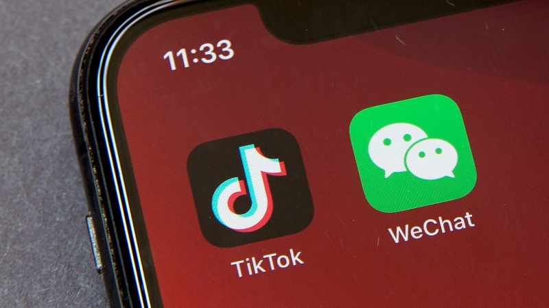 Icons for the smartphone apps TikTok and WeChat are seen on a smartphone screen in Beijing, in a Friday, Aug. 7, 2020 file photo. (AP Photo/Mark Schiefelbein, File)
