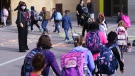 Students enter the Philippe-Labarre Elementary School in Montreal, on Thursday, August 27, 2020. Thousands of Quebec students return to class in the shadow of the COVID-19 pandemic. THE CANADIAN PRESS/Paul Chiasson