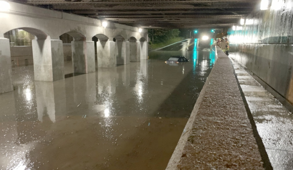 Roads were flooded in Sault Ste. Marie on Wednesday, manholes were blown off the road and water was spewing in the air.  A car was nearly fully submerged in the underpass as the driver thought he could get through the lake-like conditions.  (Photo courtesy of Keith Bowser)