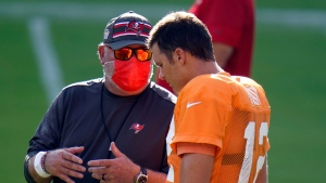 Tampa Bay Buccaneers head coach Bruce Arians talks to quarterback Tom Brady (12) during an NFL football training camp practice Friday, Aug. 28, 2020, in Tampa, Fla. (AP Photo/Chris O'Meara)