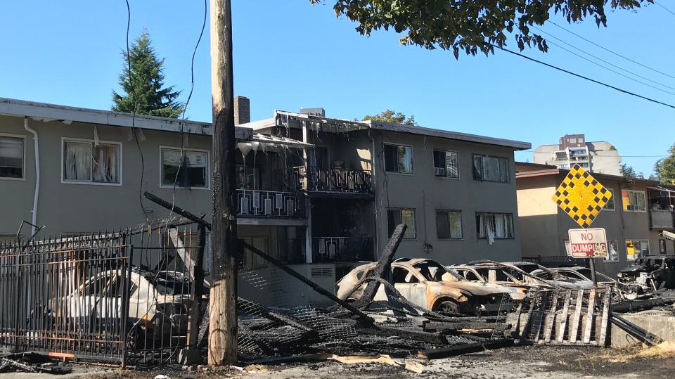 A number of cars destroyed in a suspicious fire in Burnaby are seen on Aug. 28, 2020.