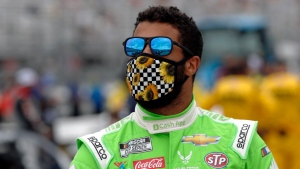 Driver Bubba Wallace waits for the start of a NASCAR Cup Series auto race, Sunday, Aug. 2, 2020, at the New Hampshire Motor Speedway in Loudon, N.H. (AP Photo/Charles Krupa)